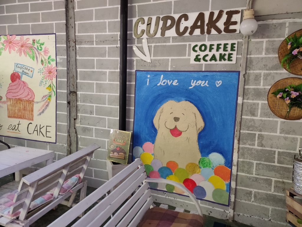 Beautiful dog mural at Cupcake Cafe