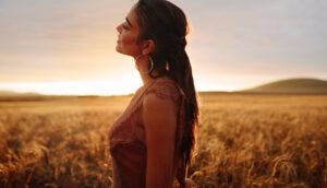 Woman enjoying countryside fresh air